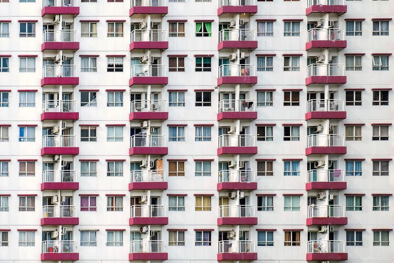 Morning in Apartment Housing in, show rows of balcony and windows. Near Jakarta, Indonesia Apartment Architecture Balcony Building Exterior Built Structure City City Life Day Full Frame House Housing Development Modern No People Outdoors Residential  Residential Building Window