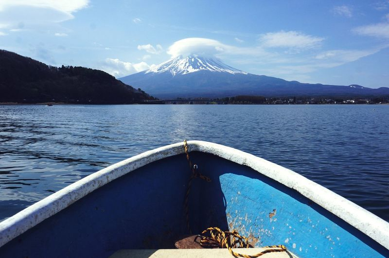 Cropped Image Of Boat On Lake With Mount Fuji In Background