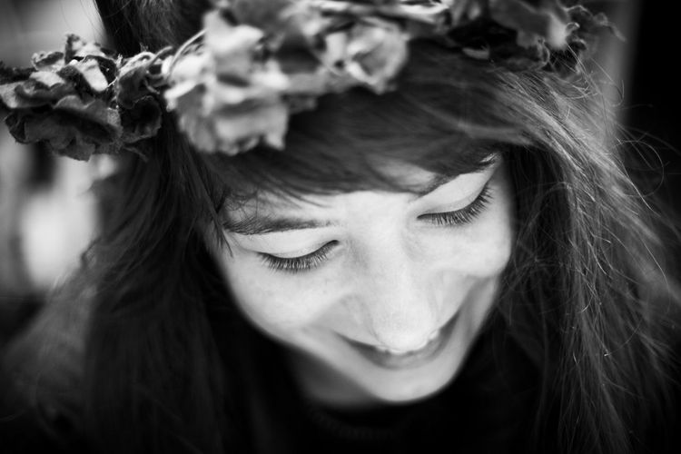 Close-up of smiling young woman wearing tiara