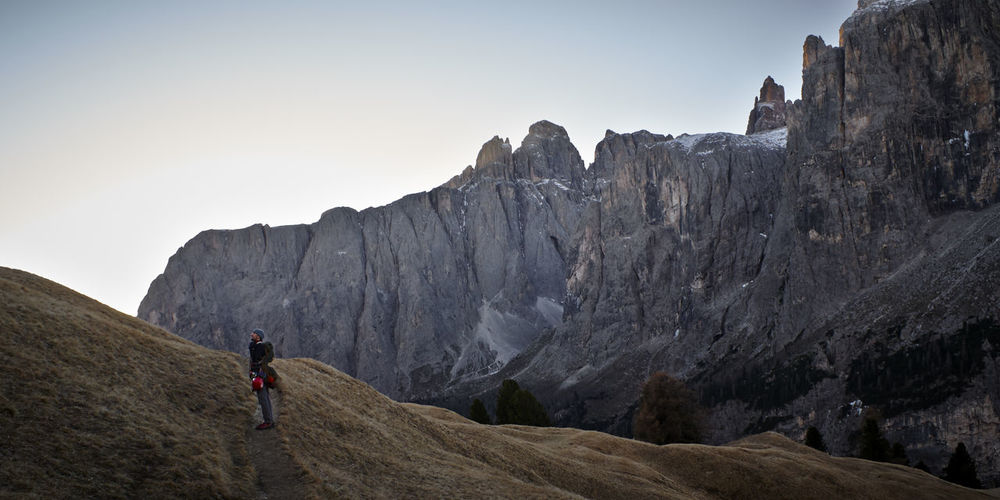 Adult Adults Only Adventure Beauty In Nature Challenge Climbing Dolomiti Italy Extreme Sports Full Length Healthy Lifestyle Hiking Landscape Lifestyles Mountain One Man Only One Person Only Men Outdoors People Rock - Object Rock Climbing Strength Sunrise Sunset Young Adult