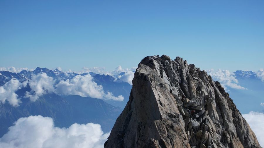 Low angle view of mountain peak, aguille de tour against sky.