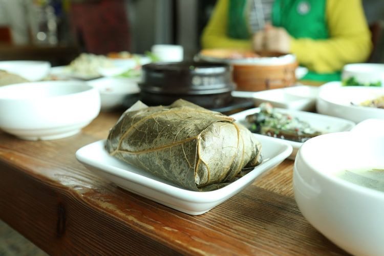 Close-Up Of Korean Food Served On Wooden Table