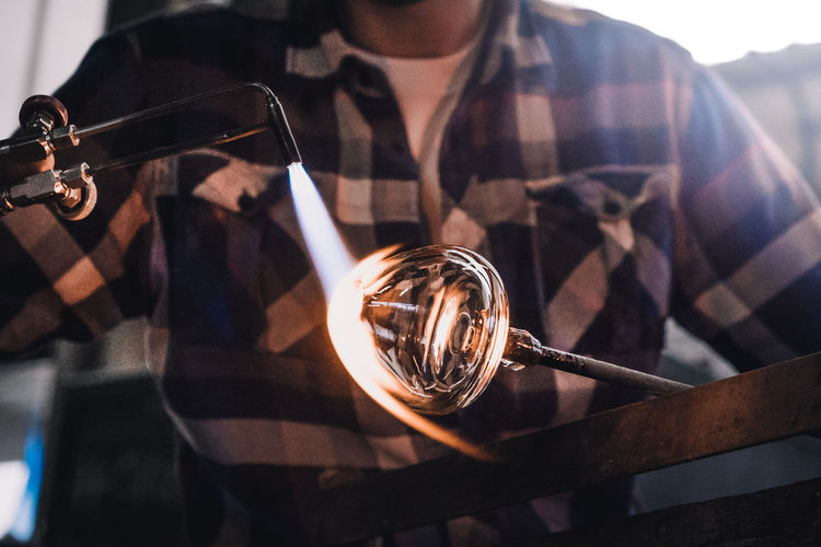 Glassblowing a whisky tumbler Craftsman Flame Hot Small Business Working Man Workshop Close-up Craftsmanship  Crystal Ball Day Glass Blowing Handmade Holding Indoors  Manufacture Manufacturing Men One Person People Real People Reflection Tourch Whisky Tumbler Business Stories