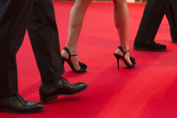 Low section of people on red carpet