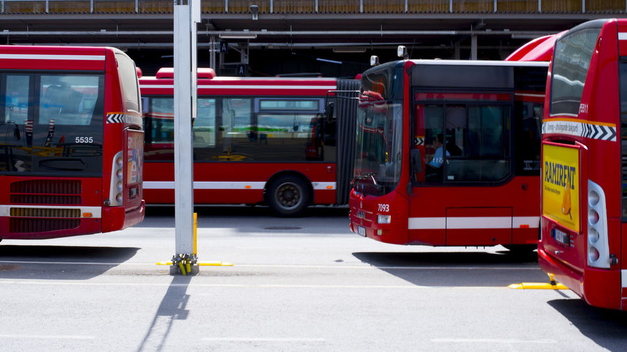 View of red bus in city