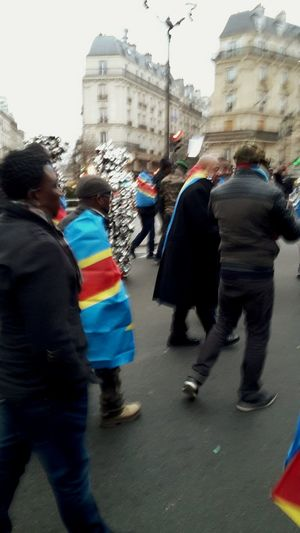 Protesting People African People Protesting Street Black People Paris Congo People Day Large Group Of People Men Blurred Motion Rear View Multi Colored Real People Walking Flag City