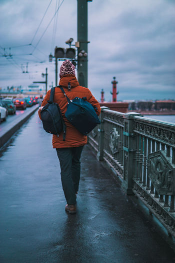 Real People Architecture Full Length One Person Sky Standing Cloud - Sky Built Structure Clothing Lifestyles Transportation Building Exterior Leisure Activity Winter Men Warm Clothing City Connection Outdoors Bridge - Man Made Structure