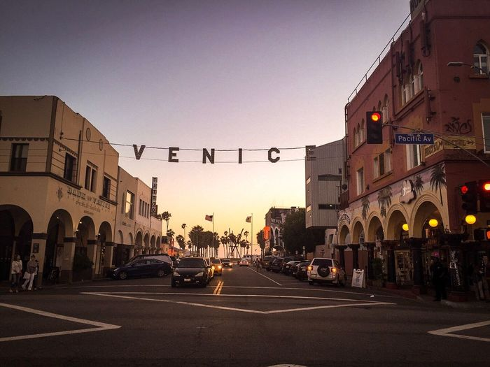 Venice Beach Architecture Building Exterior Built Structure Transportation Car Road Clear Sky Land Vehicle Street Outdoors City Sunset Large Group Of People Day Sky Road Sign People