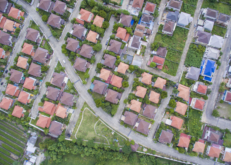 High Angle View Of Road Amidst Houses On Field