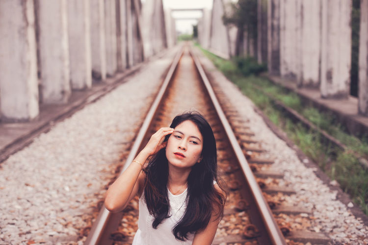 Young woman on railroad track