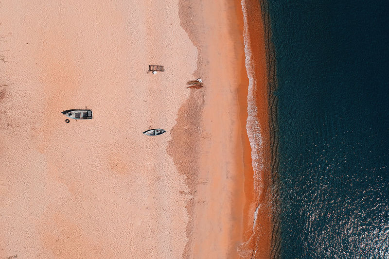 Architecture Beach Beauty In Nature Built Structure Day Land Nature No People Non-urban Scene Orange Color Outdoors Sand Scenics - Nature Sea Sport Sunlight Tranquility Wall - Building Feature Water