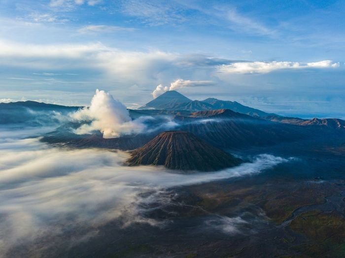 Aerial view to national park and Bromo active volcano Travel Destinations INDONESIA Bromo Cloud - Sky Sky Volcano Geology Beauty In Nature Mountain Go Higher Landscape Scenics - Nature Volcanic Crater Erupting Power In Nature Nature