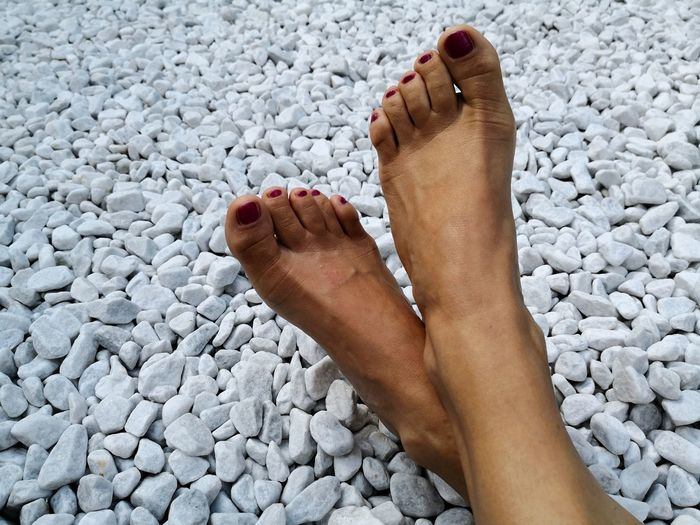 Feet of woman in Zen rockery with white marble pebbles beach Pedicureonthebeach Relaxing Moments Zen Garden Zen Rockery White Marble Pebbles White Background EyeEm Selects Low Section Nail Polish Beach Sand Human Leg Summer barefoot Pedicure Women Toe Human Toe Toenail Feet Sole Of Foot Legs Crossed At Ankle Human Foot FootPrint Thigh Red Nail Polish Human Leg Human Feet Foot The Creative - 2018 EyeEm Awards Summer Road Tripping