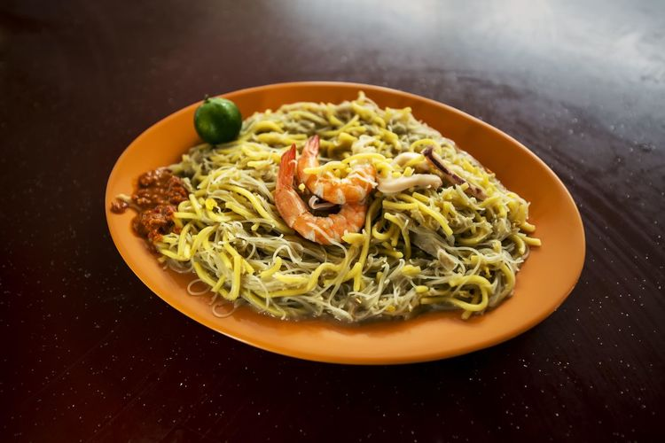 High angle view of noodles and prawns served in plate on table