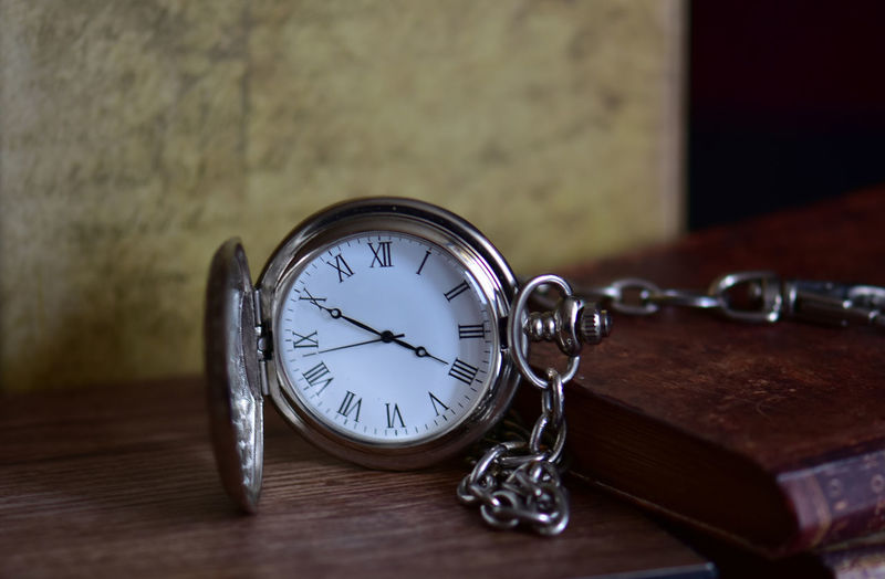Table Indoors  Time Clock No People Wood - Material Close-up Watch Still Life Antique Pocket Watch Metal Instrument Of Time Retro Styled Circle Glass - Material Old Selective Focus Number Minute Hand Clock Face Silver Colored
