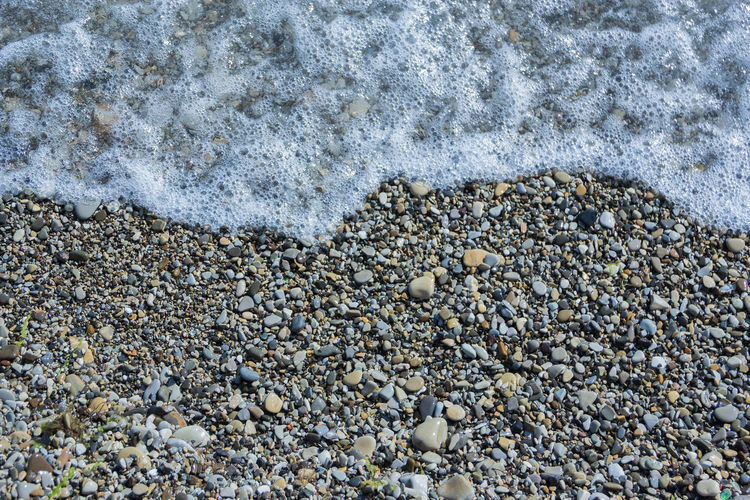 coastal part of the Black sea, sea waves, rocky beach Beach Stone - Object Solid Land Pebble Rock Stone Sand Nature No People High Angle View Day Water Aquatic Sport Sea Textured  Shell Close-up Gravel Outdoors