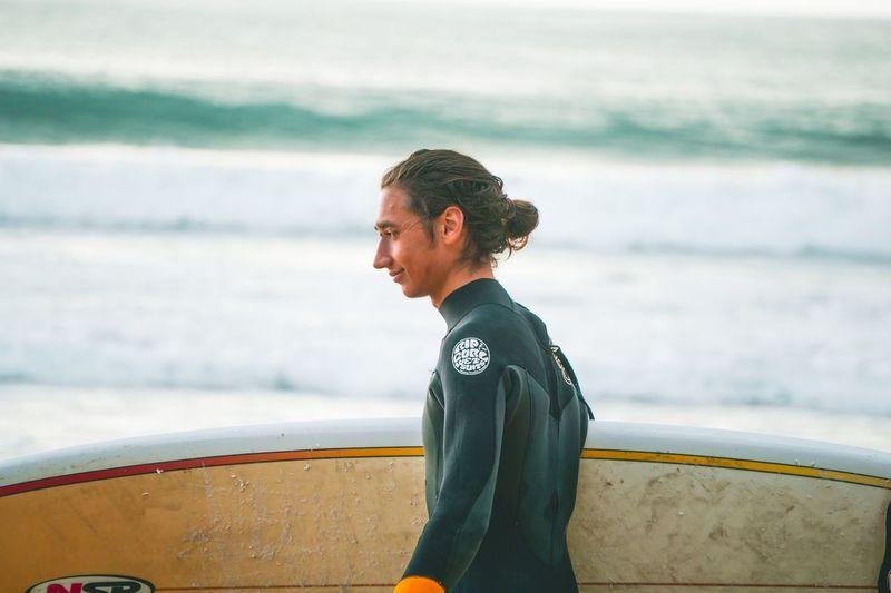 Young man looking at sea