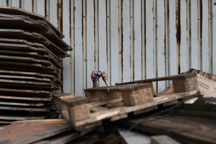 Person Photographing Behind Palettes