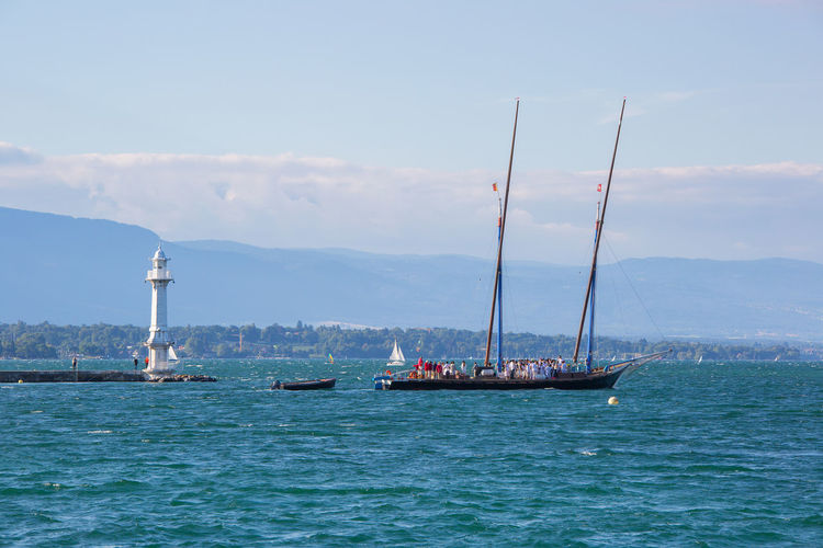 The century old Neptune boat leaving the city of Geneva, Switzerland. Ancient Beauty In Nature Boat Day Geneva Geneva Lake Lake Geneva Mast Mode Of Transport Mountain Nature Nautical Vessel Neptune Old Outdoors Sail Sailboat Sailing Scenics Sky Switzerland Transportation Water Waterfront