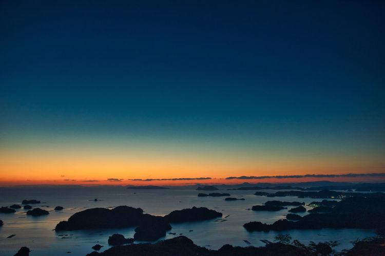 九十九島を望む黄昏時。 EyeEmNewHere Sky Sunset Beauty In Nature No People Sea Orange Color Dramatic Sky Twilight