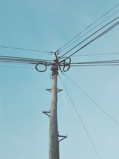 The electric wires Connection Power Line  Power Supply Electricity Pylon Electricity  Cable Technology No People Day Sky Outdoors Negative Space Wires Up The Sky Wires And Cables Wires And Sky Wooden Post Electric Wire Close Up Blue Sky Background Blue Sky No Clouds