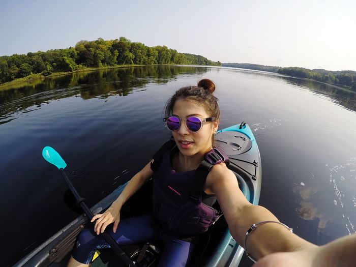EyeEm Selects Real People Water Lifestyles Transportation Leisure Activity High Angle View Nature Day Nautical Vessel One Person River Outdoors Sitting Young Women Smiling Young Adult Beauty In Nature Adventure Oar Sky