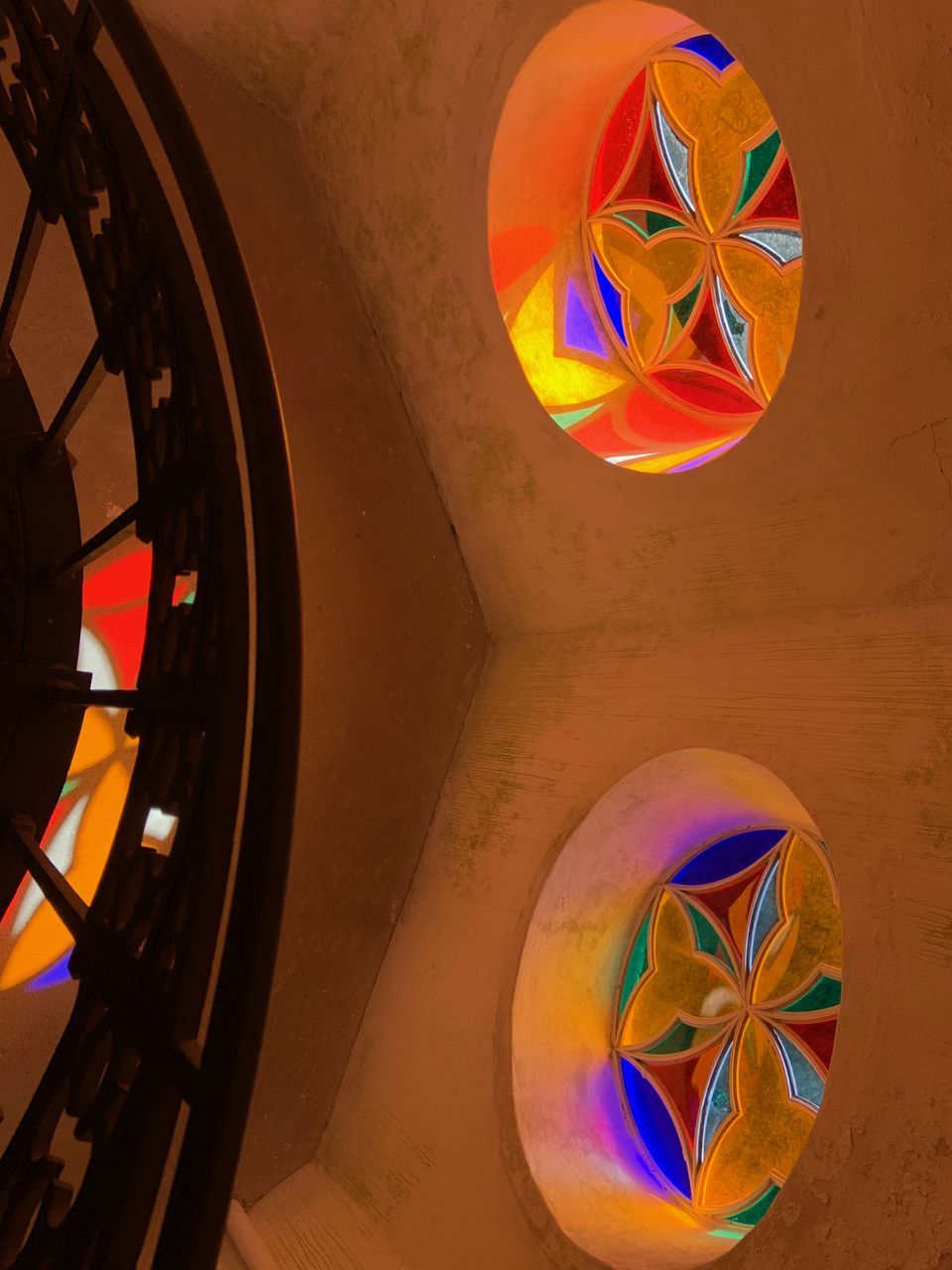 multi colored, no people, shape, indoors, geometric shape, circle, wall - building feature, design, transparent, pattern, close-up, sphere, reflection, built structure, architecture, bubble, high angle view, orange color, day, wheel