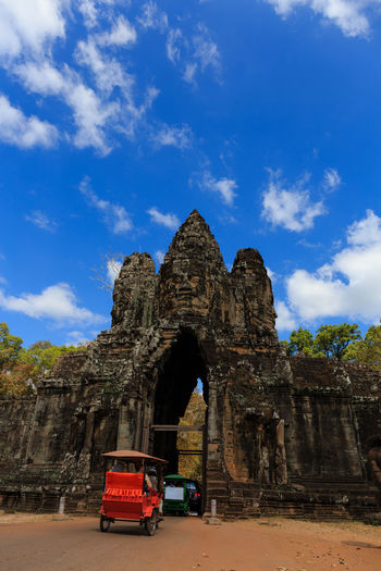 Angkor Thom Face Tower in Siem Reap, Cambodia Ancient Civilization Angkor Angkor Thom Angkor Wat Architecture Bayon Temple Buddhism Combodia Cultures Day Hinduism Khmer Landmark No People Outdoors Sculpture Siemreap Southgate Temple - Building Tourism Tower Travel Travel Destinations Tuk-tuk Vacations