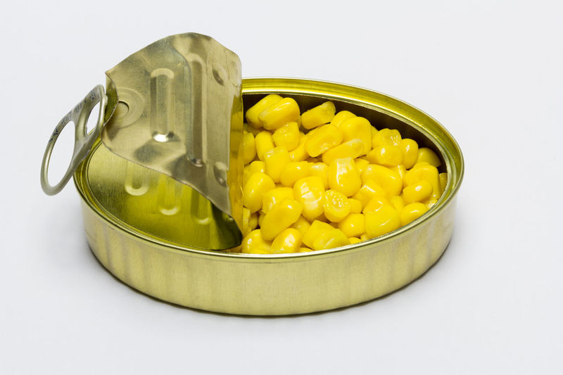 Close-up of yellow bowl on white background