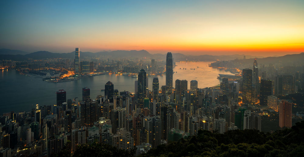 Hong Kong skyline from the peak just before sunrise Architecture Building Exterior Built Structure City Cityscape Development Downtown District Financial District  Growth High Angle View Illuminated Modern Outdoors Skyline Skyscraper Tall - High Tower Travel Destinations Urban Skyline Hong Kong China Skyscrapers No People Full Frame Travel Destination