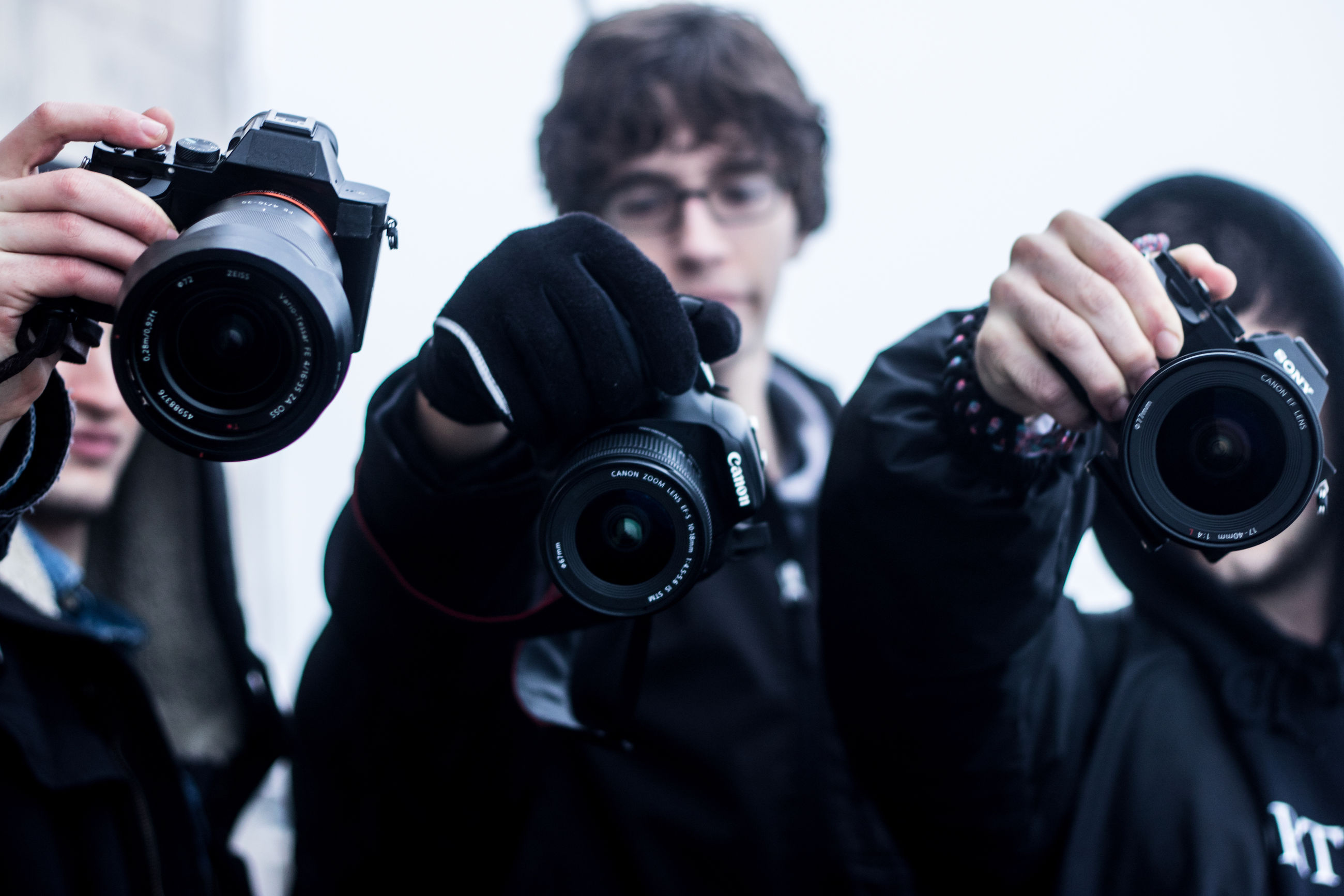 photography themes, holding, technology, photographing, lifestyles, camera - photographic equipment, person, leisure activity, wireless technology, digital camera, men, mobile phone, smart phone, indoors, communication, part of, photographer