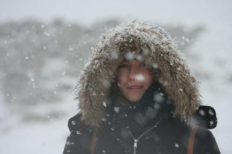 Portrait of woman in fur coat during winter