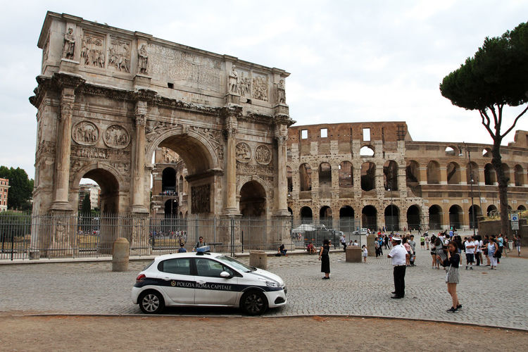 Arch Architecture Building Exterior Built Structure Car City Colosseum Day Group Of People History Mode Of Transportation Motor Vehicle Outdoors Real People Sky The Past Tourism Transportation Travel Travel Destinations Triumphal Arch