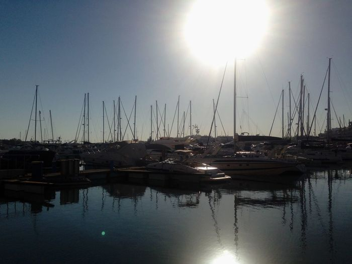 Devant l'éclair Nautical Vessel Reflection Moored Transportation Sun Water Boat Sunlight Mast Mode Of Transport Sailboat Sunny Harbor Sunbeam Clear Sky Waterfront Calm Abundance Tranquility Sea