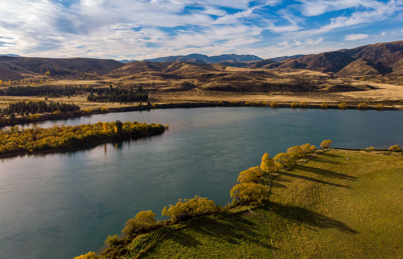 Mountain Scenics - Nature Water Lake Cloud - Sky Sky Tranquil Scene Beauty In Nature Mountain Range Tranquility Nature Landscape Environment No People Day Non-urban Scene Remote Idyllic Autumn Outdoors High Angle View New Zealand Autumn