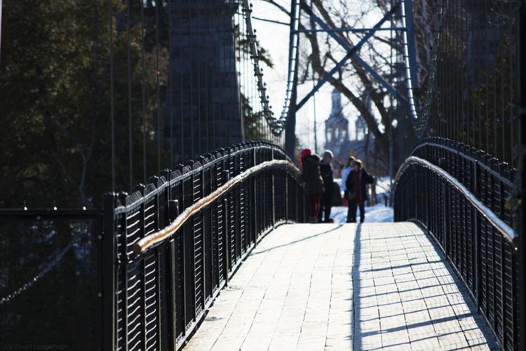 People walking on footbridge in winter
