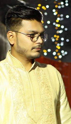 Young man in kurta looking away while standing outdoors