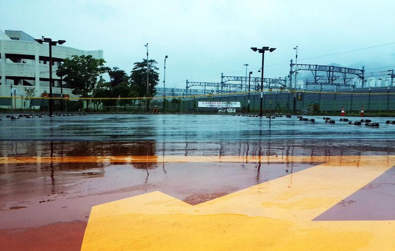 Arrow Sign Dawn E-mart No People Oilstation Outdoors Rainy Days Suncheon Yellow