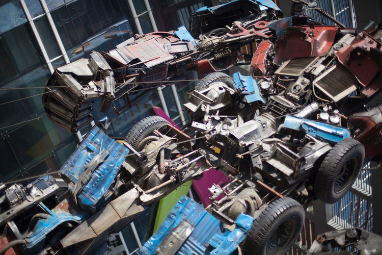 Cropped image of robot made from car scrap