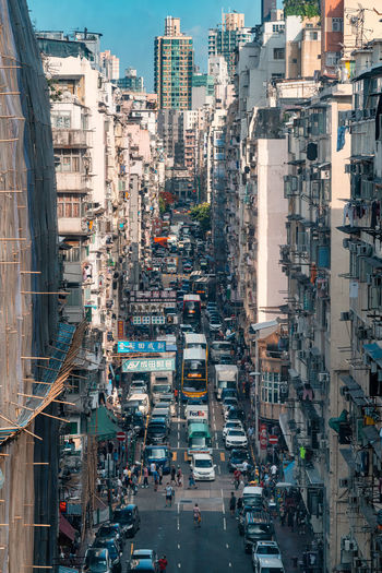 High angle view of city street and buildings, sham shui po, hong kong.
