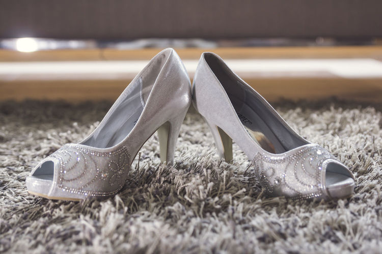 Close-up of high heels on rug
