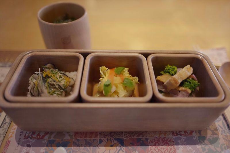 "NARISAWA Bento, February 2019 thema ""A sunny spot of Winter"" : oyster takikomi Gohan, Oita-ken / torafugu, Napa cabbage, Nagasaki-ken + Ponzu salad with kabosu, Oita-ken / Mitsuse chicken with Daikon radish, Nano-hana etc, Saga-ken. NARISAWA direction Around the Kyushu Innovative Satoyama cuisine. and burdock and Japanese beef soup, Saga-ken. at JRKYUSHU SWEET TRAIN ( Nagasaki course ) have a good time, EyeEm friend de Good Night 🤘🏻 February 2019 Food Photography Iso100 28mm F1.8 No Filter OneShot Photography Takikomigohan Salad Luxury Travel Destinations JR KYUSHU SWEET TRAIN「或る列車」 JR Kyusyu NARISAWA Bento Cuisine NARISAWA BENTO Innovetive Satoyama Cuisine Around The Kyushu Food And Drink Food Container Freshness Ready-to-eat High Angle View Still Life Close-up Japanese Food Tray Healthy Eating Group Of Objects"