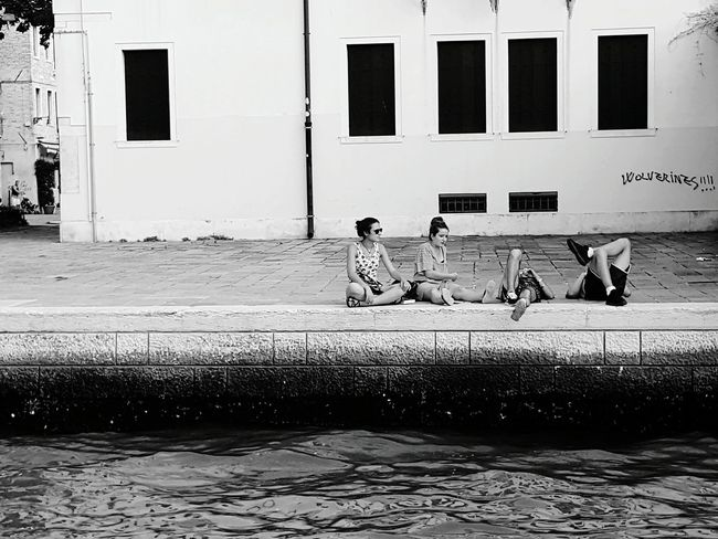 People Together People Street Waterfront Sitting Side View Full Length Outdoors Riverbank Scenics Popular Telling Stories Differtenly Every Picture Tells A Story Relaxing Life Lifestyles Culture Streetphotography Canals And Waterways Water Peoplephotography People Of The Oceans My Favorite Place People And Places My Year My View The Street Photographer - 2017 EyeEm Awards The Photojournalist - 2017 EyeEm Awards An Eye For Travel Adventures In The City