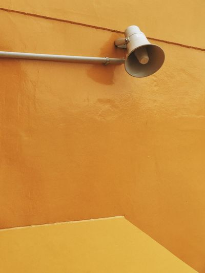 Megaphone on orange wall