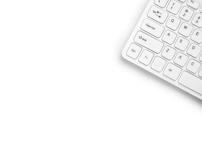 High angle view of computer keyboard over white background