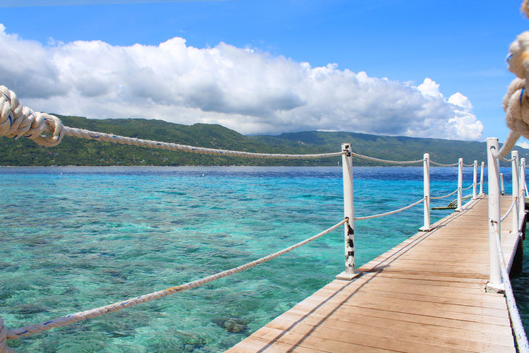 Outdoors Blue Water Sea Day Mountain Vacations Sky Summer Beauty In Nature Nature Landscape Beach Scenics