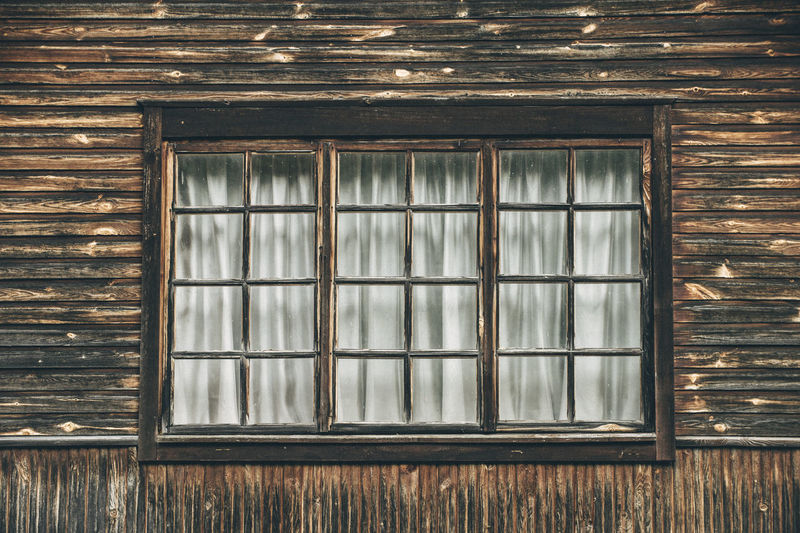 Close-Up Of Closed Window In Old Wooden House