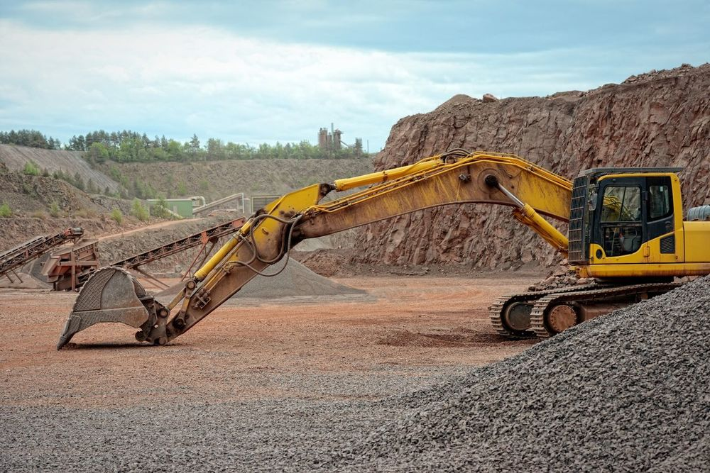 earth mover and stonecrusher in open pit mine. mining equipment Steinbruch Bagger Quarry Pit Bergbau Mine Mining Open Pit Mine Excuvator