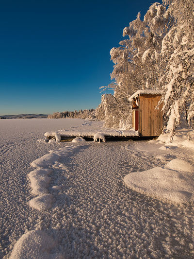 Wonderland Architecture Winter Nature Building Exterior Blue Sky Snow Built Structure Cold Temperature No People Land Day Building Copy Space Clear Sky Sunlight Landscape Scenics - Nature Outdoors Arid Climate Climate River Bank  Wonderland Sweden Olympus