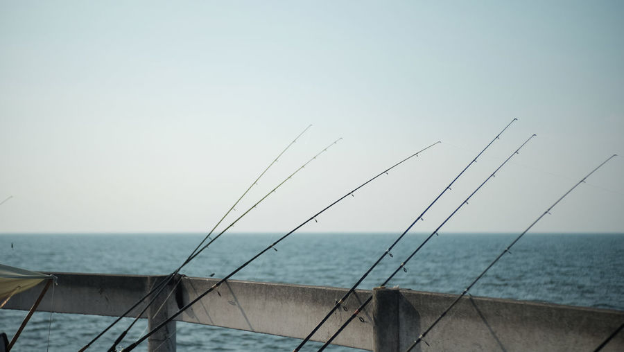 Fishing Poles Blue Clear Sky Day Fishing Pole Nature Nautical Vessel No People Outdoors Sea Sky Water